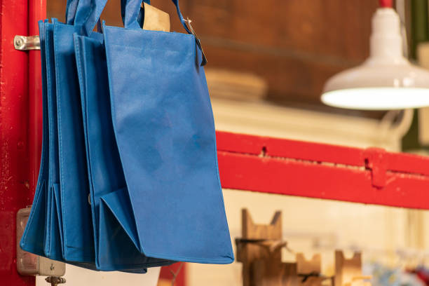 Blue foldable reusable shopping bags for sale at a Market.